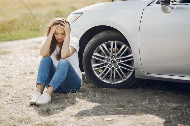 worried-young-woman-sitting-near-broken-automobile-at-4173090 (1)